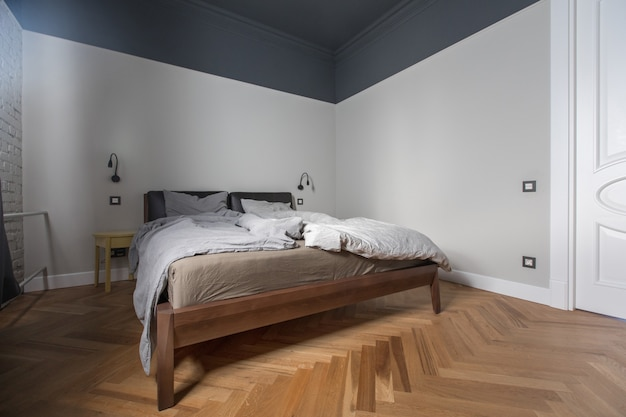 Interior of bedroom with unmade bed