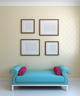 Interior.blue ottoman with crimson pillow and emty frames on the wall