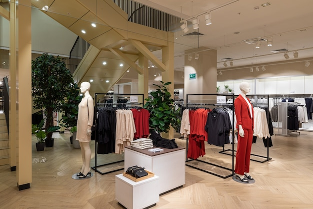 Interior of brand new fashion clothes store.