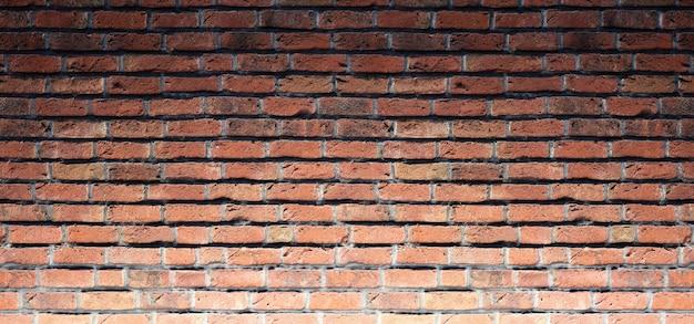 低照度で内部のレンガの壁の建設の背景。