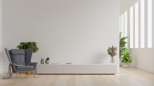 Interior of a bright living room with armchair on empty white wall