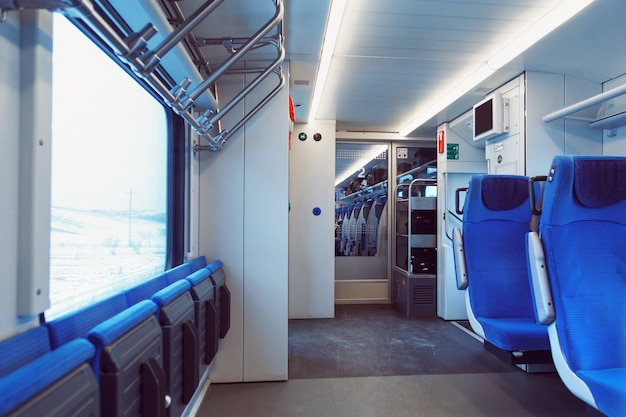 The interior of carriage with seats for passengers and their bicycles in high-speed commuter train.
