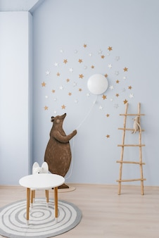 The interior of the childrens room is decorated in blue and beige colors