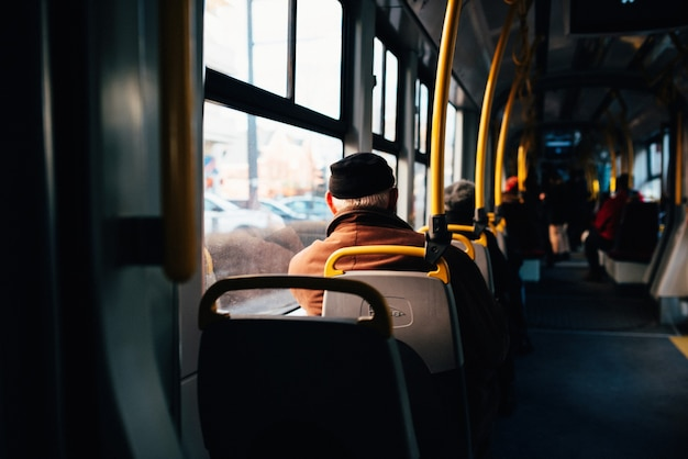 Interior of a city bus with yellow holding rails