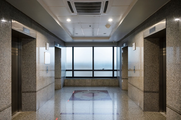 Interior of closed marble elevator hall in the office