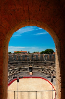 The interior of the colosseum or coliseum in arles, france. selective focus