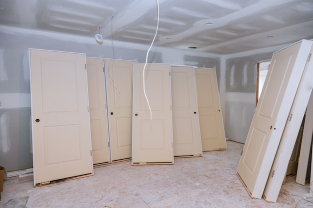 Interior construction of housing project with door installed