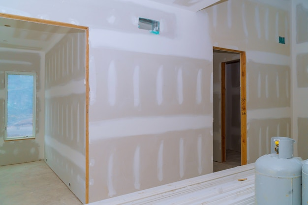 Interior construction of housing project with drywall installed door for a new home