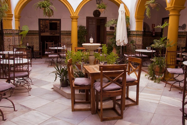 Interior of a cordovan restaurant with a beautiful andalusian patio. cordoba, andalusia, spain.