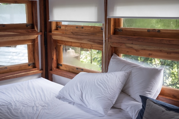 Interior cozy bedroom in wooden house at morning