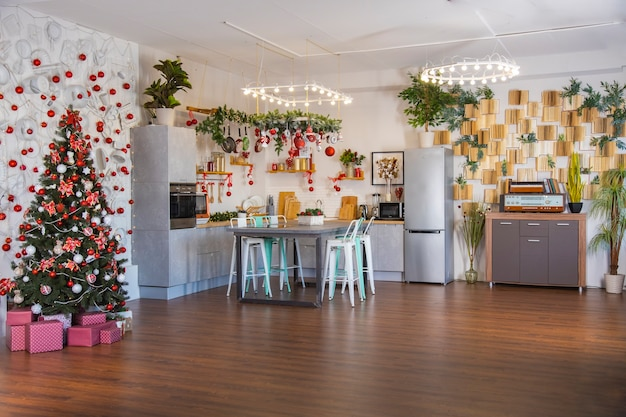 Interior of a cozy modern spacious kitchen for a large family, decorated for the new year celebration...