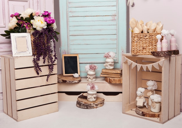 Interior decoration setup with flowers and picture frames