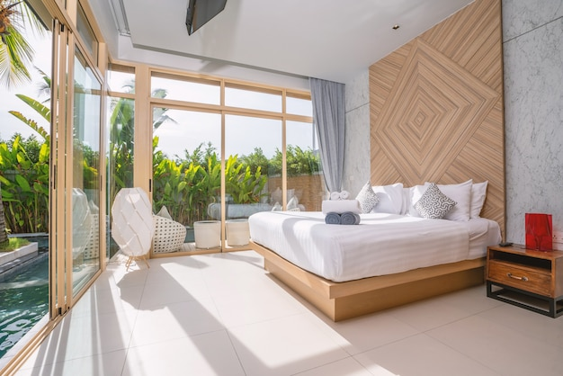 Interior design in bedroom of luxury pool villa, house, home feature swimming pool