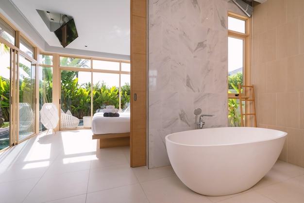 Interior design of bedroom with bathtub in villa, house, home,