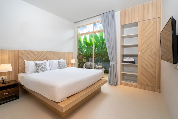 Interior design in bedroom with green garden and balcony in the house