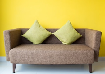 Interior design by brown sofa and green pillow in living room