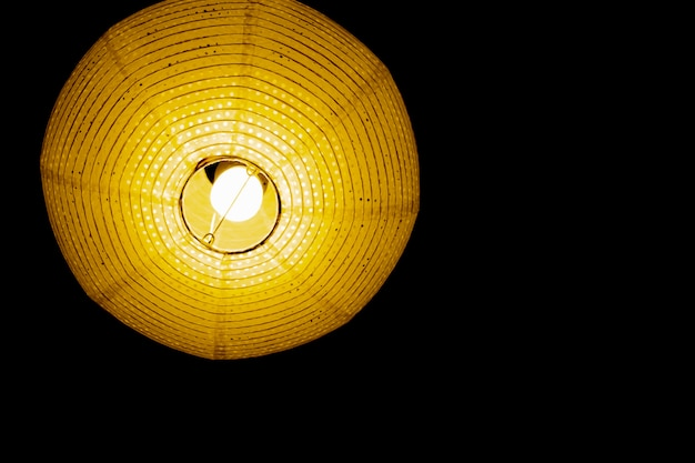 Interior design of lamp. a led light bulb is illuminating and hanging under a house roof.