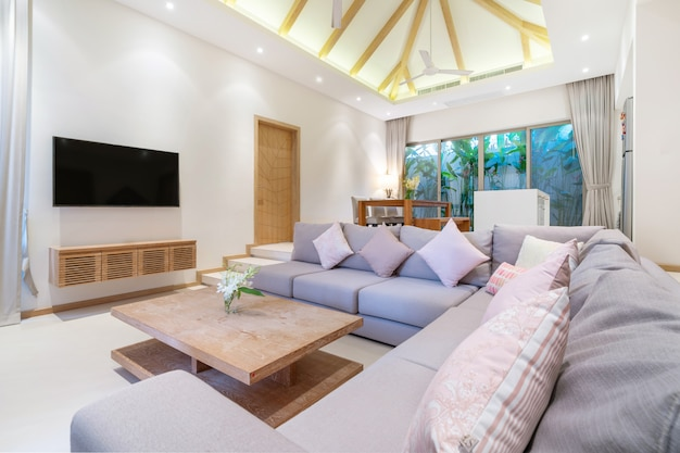 Interior design in living room with open kitchen area