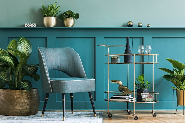 Interior design of luxury living room with stylish armchair, gold liquor cabinet, a lot of plants and elegant personal accessories. green wall panelling with shelf. modern home decor.