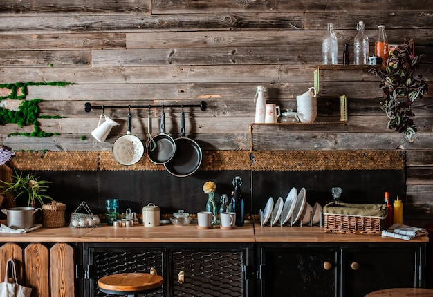 Interior and design of modern home kitchen in rustic style. in the background is a wall of wooden planks.