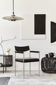 Interior design of modern living room with black stylish commode, chair, mock up art paintings, lamp, pouf, decorations and elegant accessories in home decor. template.