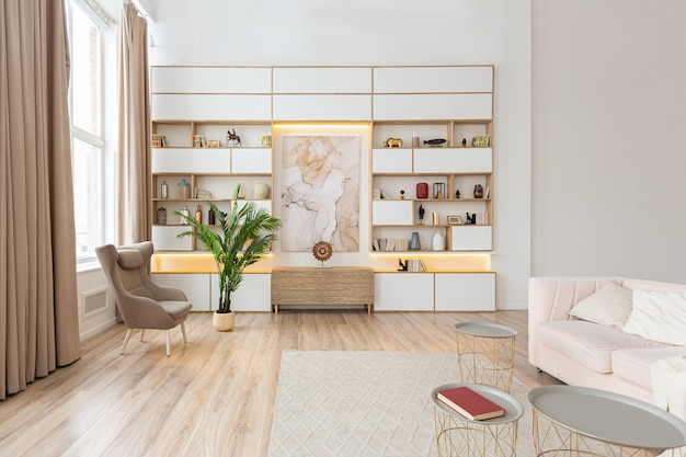 Interior design spacious bright apartment in scandinavian style and warm pastel white and beige colors. trendy furniture in the living area