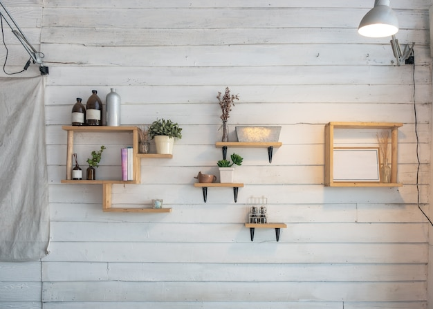 Interior design of wooden shelf with art object decoration