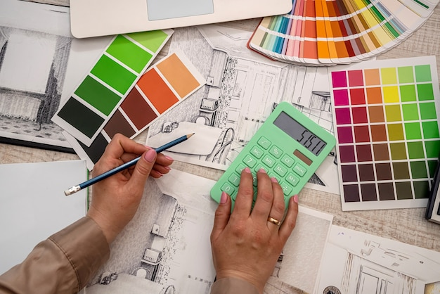 Interior designer's hand selects a color from the palette. renovation concept