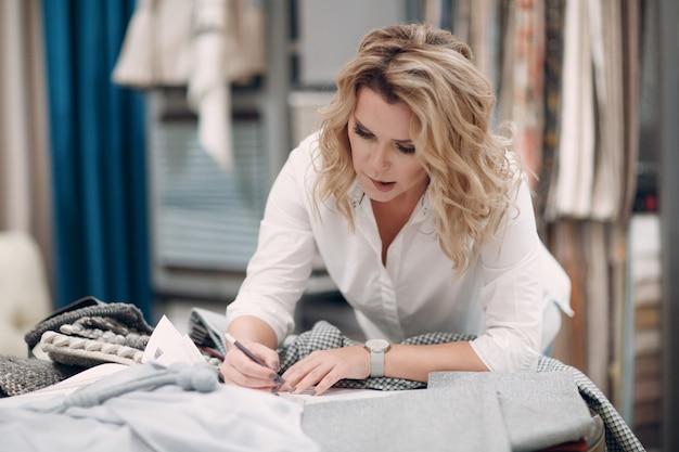 Interior designer woman at work design and interior decoration with fabric