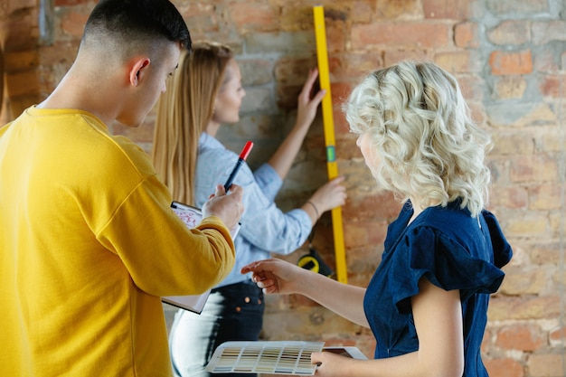 Interior designer working with young couple.