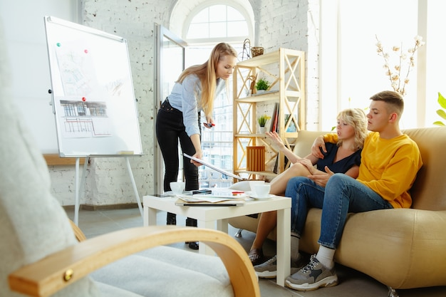 Interior designer working with young couple
