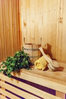 Interior details finnish sauna steam room with traditional sauna accessories basin birch broom scoop towel.