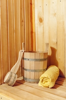 Interior details finnish sauna steam room with traditional sauna accessories basin scoop towel.
