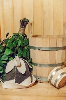 Interior details finnish sauna steam room with traditional sauna accessories. bathhouse spa