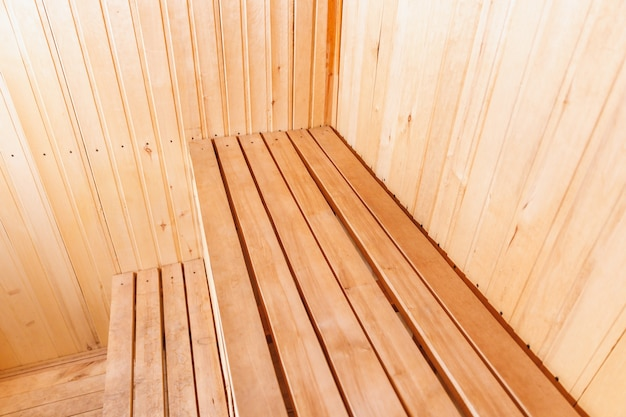 Interior details of traditional finnish sauna steam room. traditional old russian bathhouse spa concept. relax country village bath concept.