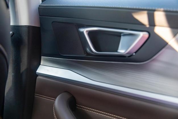 Interior door handle of a modern premium car closeup