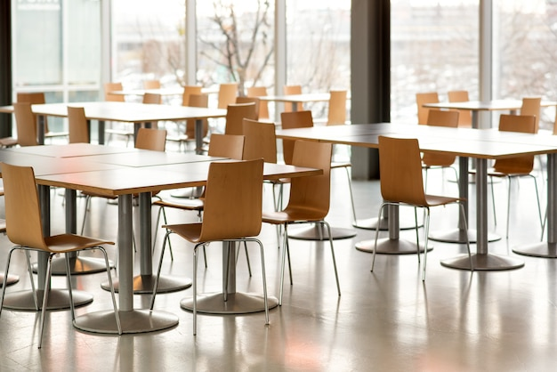 Interior of empty canteen with tables and chairs