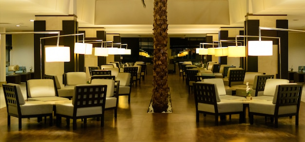 Interior of an empty restaurant in the evening