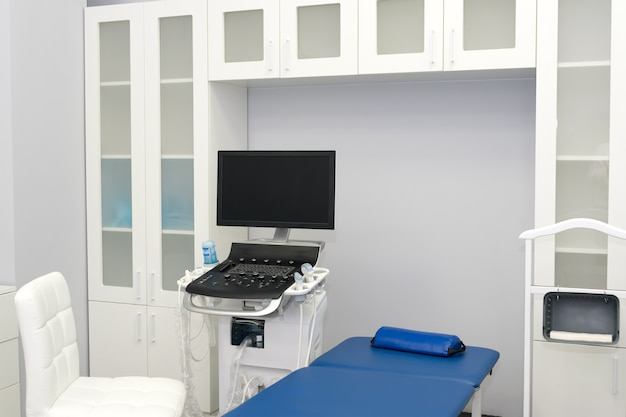 Interior of examination room with ultrasonography machine in hospital laboratory. modern medical equipment background. ultra sound machine, usg, sonogram screening