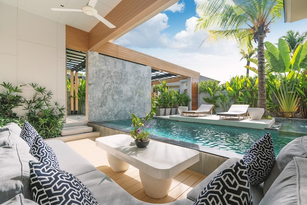 Interior, exterior design of luxury pool villa, house, home feature living room with swimming pool