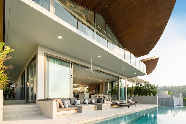 Interior and exterior design of luxury pool villa, house and home feature terrace and sun bed