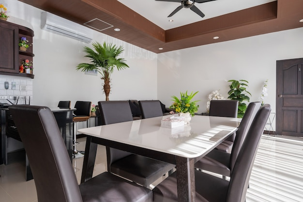 Interior and exterior design of open space living room and dining area feature wooden dining table
