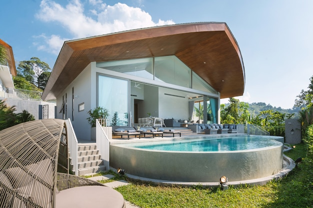 Interior and exterior design of pool villa, house, and home feature garden and infinity swimming pool