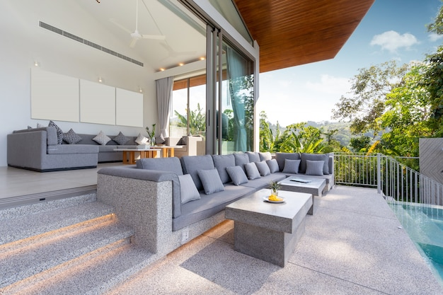 Interior and exterior design of pool villa, house and home feature sofa and cushion by pool terrace