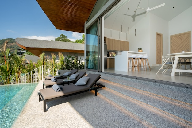 Interior and exterior design of pool villa, house and home feature sun bed on terrace with open space living room