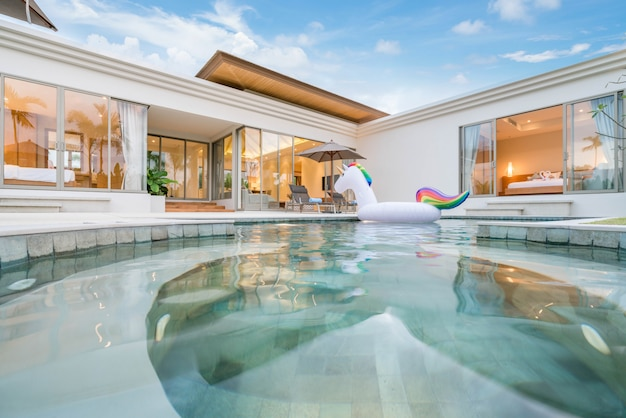 Interior and exterior design of pool villa which features living area
