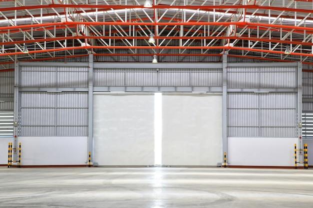 Interior of factory with shutter door, day  scene.