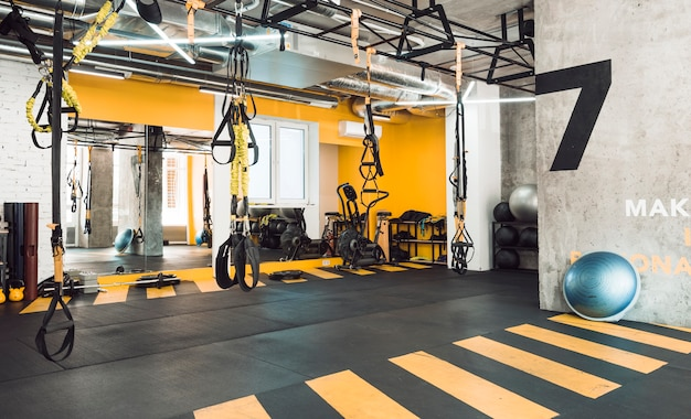 Interior of fitness club with exercise equipments