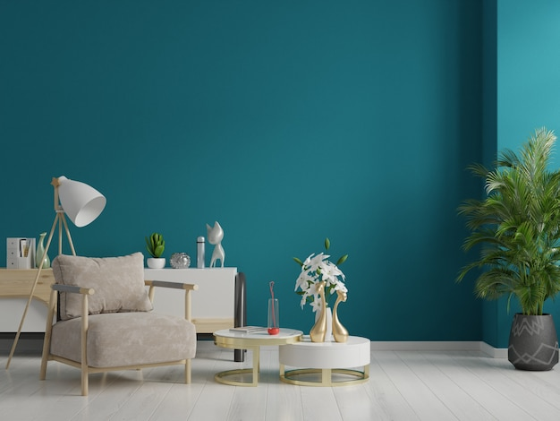 Interior has a armchair on empty dark green wall