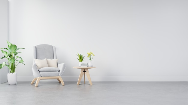 The interior has a armchair on empty white wall
